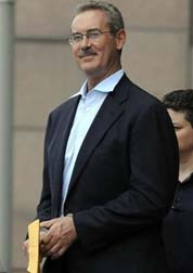 Allen Stanford escorted out of the federal courthouse in Houston June 29, 2009. Pat Sullivan/ AP Photo